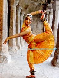 a girl in bharatanatyam dance pose