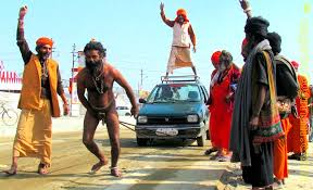 naga babas pulling a car with a rope attached to his penis