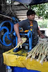 a sugar cane juice seller