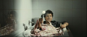 jamal salim in a tub filed with money in slumdog millionaire