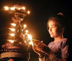 child lighting a lamp