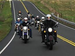 men traveling in motorcycles